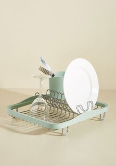 With all the chic kitchenware you possess, you're going to need a dish rack that's just as stylish! Enter, this metal drying station. With mint green accents and a plastic cup for your utensils, this mod dish holder provides fashionable storage for your bowls and plates while you wait for their rinse to evaporate.