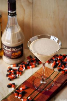 A thoroughly grown up take on a beloved family favourite: Pumpkin Pie Martinis. #drinks #cocktails #Halloween #fall #autumn #martini #pumpkin #candy #corn