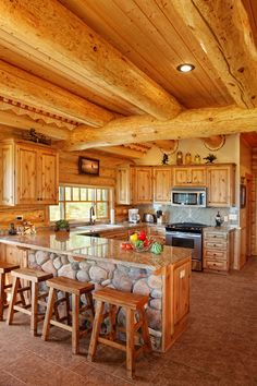 Log home kitchen-LOVE the cobblestone!!!! Bebe'!!! Modern kitchen with a rustic look!!! Love the some front of the eat on bar!!!