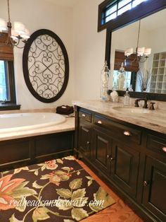 Master Bathroom Makeover...black cabinets and accents...very nice!
