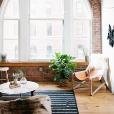Madelynn Furlong's Minneapolis Apartment Tour. Most of the wooden furniture is handmade by the homeowners!(via The Every Girl)
