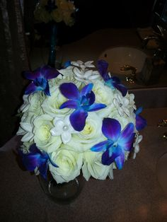 Bridal Bouquet-White Roses, White Stephanotis and Blue Orchids.