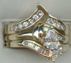 This ring features a 1/2 carat pear cut diamond in the cneter with baguette diamonds in the 14 kt. yellow gold ring.   www.facebook.com/middiajewelry  middia53@gmail.com