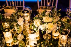 Close up of the flower compositions in the crystal vases. White roses, wild greenery and hydrangeas.