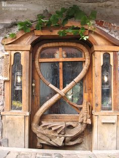This is the entrance to one of the 400 year old stone houses on the banks of the Vltava River that snakes, like the tail of this dragon, through Cesky Krumlov in the Czech Republic. More to discover about natural living at www.naturalhomes.org