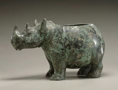 Ritual vessel (zun or gui) in the shape of a rhinoceros; probably 1100-1050 BCE; China, Shandong province, Shang dynasty (1600-1050 BCE); bronze; Asian Art Museum, San Francisco, California. Traditionally, this animal-shaped bronze has been thought of as belonging to a type of wine vessel called a zun; this designation is supported by the inscription. The zun is a pouring vessel and with a spout, usually the head of the animal.