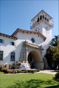love the raised tower and arch openings.  love the clock, love the cutout above entry and shutters