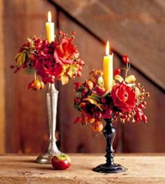Add seasonal flair to year-round accessories. Here a couple of mismatched candlesticks are given an instant fall update with fresh flowers and berries. The punch of color sets the tone for warm and cozy interiors. These can be tucked on a shelf, end-table or mantle and enjoyed for days. To get more mileage try using silk flowers.
