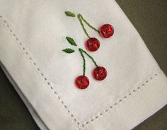 Cherry embroidered napkins (Need: 4 red buttons, embroidery floss, white cloth)