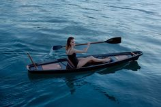 Carbon fibre, teak and gold plated brass. Kayak designed by Jamie McLellan and Andy Jacobs. McLellan Jacobs