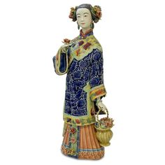 Chinese Porcelain Doll. Flower collecting is a traditional leisure activity for maidens in China as depicted in this porcelain figurine in early Qing (1644) costume. Oriental porcelain decor.