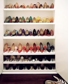 Built in shoe rack for entry - large space on bottom for boots with tray underneath.  John Loecke & Jason Oliver Nixon Photo - Shoes on display on white shelving