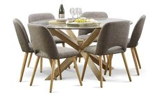 The Miles 1500 round glass top dining table is a spacious design which is supported by chunky timber geometrical timber legs. With a scandi influence and 6 dining chairs, this is sure to be a centre piece of any living room