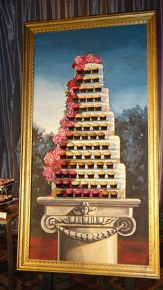 """These delicious Sweet cupcakes are mounted on the actual painting for display at a wedding at the Waldorf Astoria Orlando creating a perfect """"Cupcake Portrait""""."""