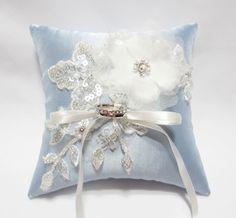 Wedding Ring Pillow Cream Satin Organza Blossom on Pale Blue Pillow. $40.00, via Etsy.