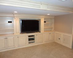 Built in entertainment center for basement.. possible closed cabinet on top to hide utility box and a matching one on other side just for storage