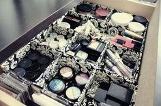 Simple makeup storage.I like the black and white boxes to protect your drawers from makeup stains