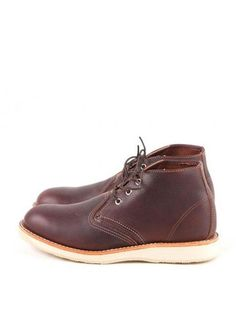 Redwing Brown Chukka Boot: Redwing's dark brown Chukka Boot is a classic that was designed for lighter work. Popular amongst carpenters who needed sturdy, but light and flexible Redwing shoes, the Chukka features Redwing's classic Atlas Tred white crepe and three eyelets for quick fastening. Both casual and sportive, this is still a high performance shoe made from premium oil-tanned full-grain leather made in Red Wing's S.B. Foot Tannery.