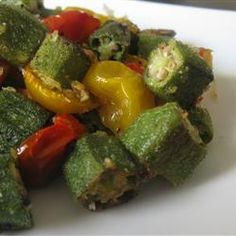 A new obsession.  Un-Slimy Okra Recipe - Roasting the okra with tomatoes keeps it from being slimy, and a dusting of panko adds a touch of crunch to mimick fried okra without the added fat from frying.  Bake for 13 to 15 minutes until the tomatoes are soft and the okra is lightly browned.  Tastes like fried!  - Okra is so yummy!!!