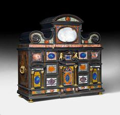 """""""PIETRA PAESINA"""" CABINET. Florence, 17th century. Ebonized wood, exquisitely inlaid with """"Pietra Paesina"""" marble as well as with brass and tin fillets. Rectangular body with scrolled top and handles on the side, on a straight frame with spherical feet. Structured front with central drawer """"en fausse porte"""" between 3 drawers. Secret compartments. Fine gilt bronze mounts and applications. 79 x 33 x 79 cm. -Koller Auctions- Luxury Furniture, Antique Furniture, Renaissance, Ivory Cabinets, Art Cabinet, Pieter Bruegel The Elder, Cabinet Of Curiosities, 17th Century Art, Secret Compartment"""