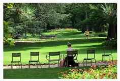 People relaxing in Luxembourg Gardens.