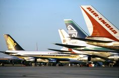 Air New Zealand 747-219 surrounded by other classic 747's at Perth Airport circa mid 1980's. Image via google