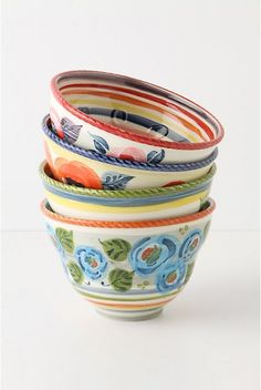 """All Around The Garden Bowl. Take a stroll through the sketched bachelor's buttons and whimsical motifs that sprout unexpectedly from this sleek stoneware creation, suitable for cereal, soup and salad.  Stoneware.  Dishwasher and microwave safe.  21.5 oz.  3.5""""H, 5.25"""" diameter…"""