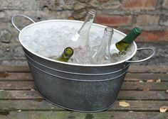 Crocus. (n.d.). Drinks bucket. [Online]. Available from: http://www.crocus.co.uk/product/_/drinks-bucket/classid.2000016198/ [Accessed: 6 June 2013] £14.99 Galvanised with and antique finish and a powder coating.    Dimensions: height 22cm x length 44cm x width 30cm