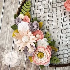 Youll fall in love with this rustic chicken wire wreath that beautifully combines farmhouse chic chicken wire with romantic pink, blush, white, and gray felt flowers. The thin grapevine and wire wreath is a perfect pairing with the delicate flowers, leaves, and fronds. You'll find multiple varieties of roses, poppies, gerbera daisies, ranunculus, and others. This wreath would be a striking addition to a wedding, nursery, or special room in your home. - 14.5 round wreath - Created from…