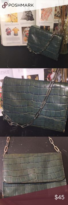 💯Ginuine Leather Vintage Clutch The Limited🎀 This leather Croc print is a Teal Green Color, has metal links as the strap, inside pocket. This has been purchased when The Limited sold Leather merchandise. Way... back!!! Has natural leather wear. It was packed away so still has life. Time to wake her up🎀❤️👛💕 The Limited Bags Mini Bags