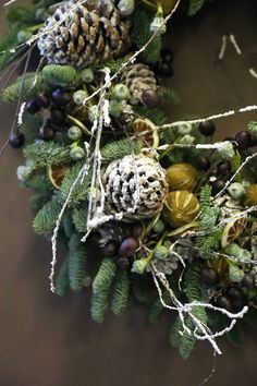 Frosted Pine cone, dried lemons and eucalyptus flower detail of a Christmas wreath designed by Phillo flowers in London UK