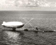 U.S, Navy Submarine USS Poacher (SS-406) rescuing a disabled ZP2K airship.