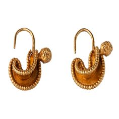 A Pair of Gold Stylised Makara Earrings Liao Dynasty 11th century www.ollemans.com