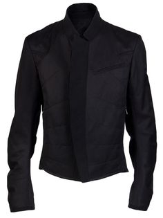 Rise phantom jacket in black from Ann Demeulemeester. This cotton-blend jacket features a mock collar, front concealed button down panel, a single chest pocket, and two front zipper pockets. Has ruched long sleeves, front and back embroidery stitching, and an interior pocket.