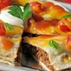 JIMMY'S SPECIALLY SEASONED GROUND BEEF, REFRIED BEANS, SALSA, AND CHEESE LAYERED BETWEEN TWO FLOUR TORTILLAS FOR A MEXICAN INSPIRED DEEP DISH PIZZA.