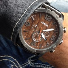 The earthy tone of this wooden faced Fossil watch would go perfectly with a dark blue shirt or suit! Try it!