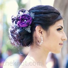 All the bridesmaids wore matching purple flowers in their updos.