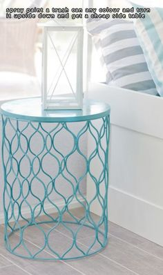 Spray paint a trash can any color, turn it upside down and you have a cheap side table
