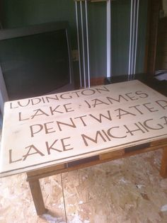 Upcycled table -- included our favorite vacations spots in Michigan: Ludington, Lake James, Pentwater and Lake Michigan