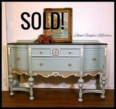 (SOLD) 1920s Jacobean Grand Buffet / Sideboard. A conversation piece! Custom painted a soft, muted neutral blue with cocoa highlights. Trimmed in vanilla with hints of gold glazing on legs. Top is a deep, rich dark chocolate java gel stain. Top front drawer has sections for flatware. Drawer beneath and 2 side doors give you plenty of storage space for your linens. It measures 65 wide x 21 deep x 40 tall . This piece just makes me smile. Pick up in Hopewell, NJ. (Between Flemington and…