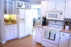 Benjamin Moore White Dove painted cabinets with white appliances. Copying this in the foursquare kitchen with Fresh Cream walls.