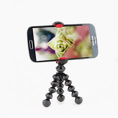 Gorillapod Mobile (iphone tripod)   Works with every phone ever, even with a case on.