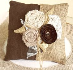 Some throw pillows in Choc brown would be nice, maybe some teal too.  Brown & Burlap Ring Pillow...love love love this.