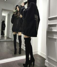 Baggy hoodie. Thigh high boots
