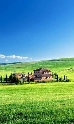 Tuscany landscape with typical farm house, Italy