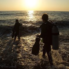 Photo by @TimLaman.  Sunrise dive on the North shore of Bali.  Graham Abbot and @RussLaman heading out to explore that completely different universe under the waves.  #Bali #Indonesia #scubadiving #adventure @thephotosociety @natgeocreative @TimLaman. by natgeo