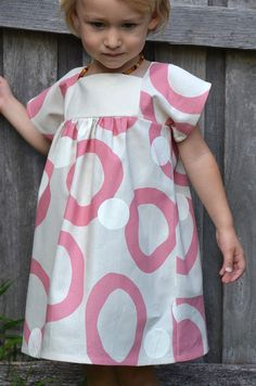 little girls dress in screen printed pink and white disc design