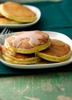 These fluffy Eggnog Pancakes with Maple Butter Rum Drizzle are sure to delight as you are ringing in the new year!