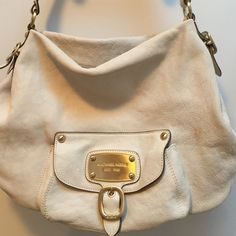 """Authentic MK purse Used authentic MK purse with a stain on the front as shown in the pictures. Gold hardware  16"""" across  12"""" down  strap is 10"""" one outside pocket 5 inside pockets and one of them had a zipper please ask any questions before buying it is a loved purse Michael Kors Bags Shoulder Bags"""