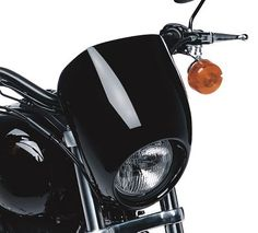 Add an element of racy style to stock headlamps with this visor.